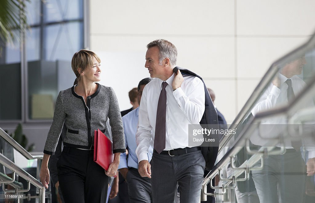 Smiling group of businesspeople walking