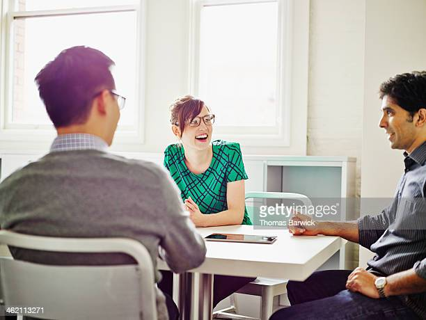 Smiling group of coworkers discussing project