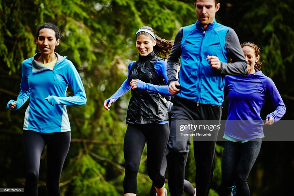Smiling group of friends running together