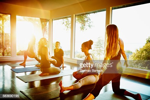 Smiling group of women stretching after yoga class