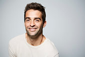 Smiling guy with brown eyes in studio