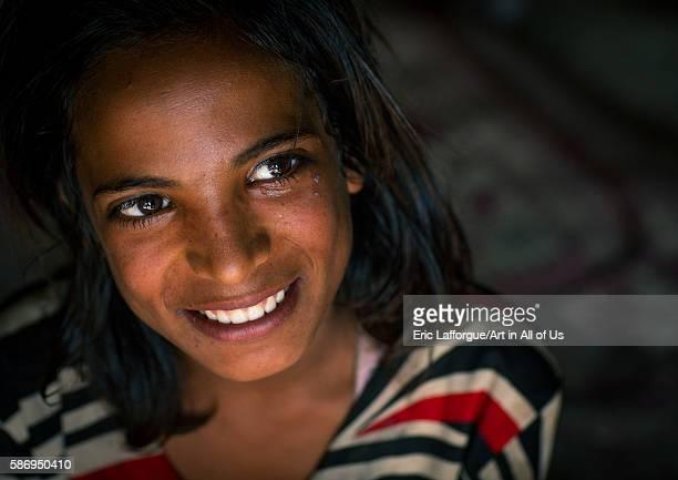 Smiling gypsy teenage girl central county kerman Iran on January 1 2016 in Kerman Iran