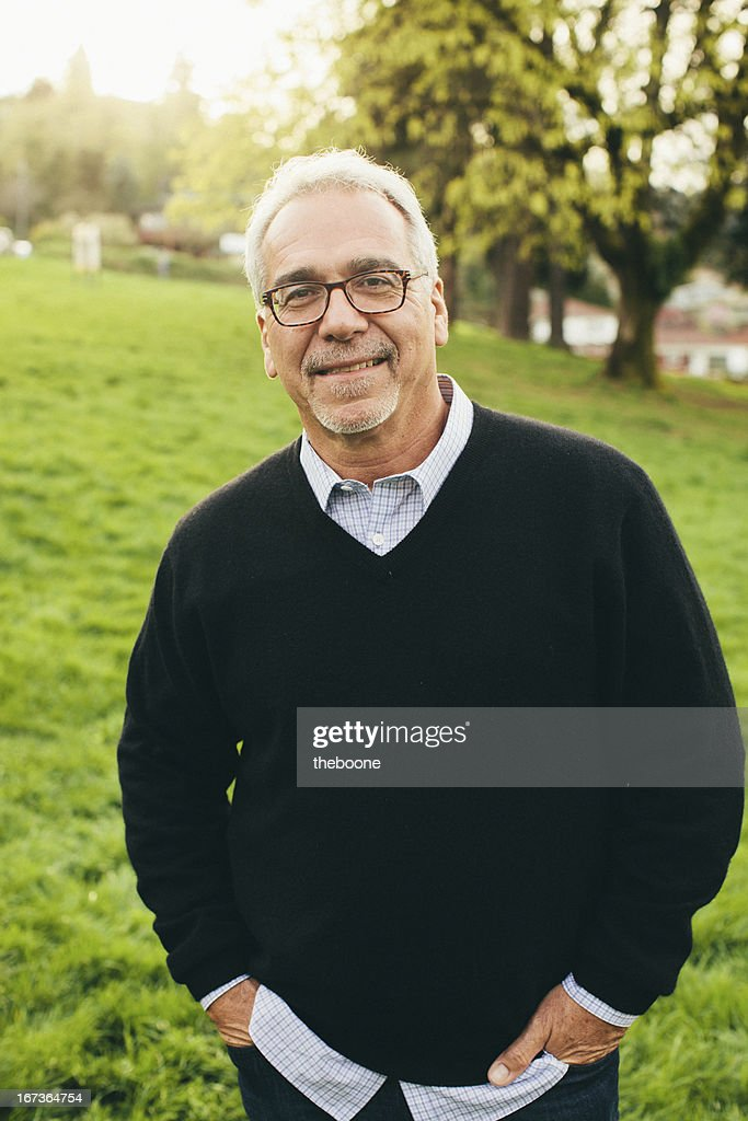 Smiling Handsome 5060 Year Old Man Stock Photo Getty Images