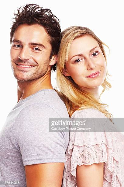 Smiling handsome man and woman standing against white