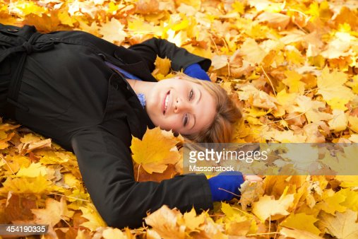 Smiling happy girl in autumn park. : Stock Photo