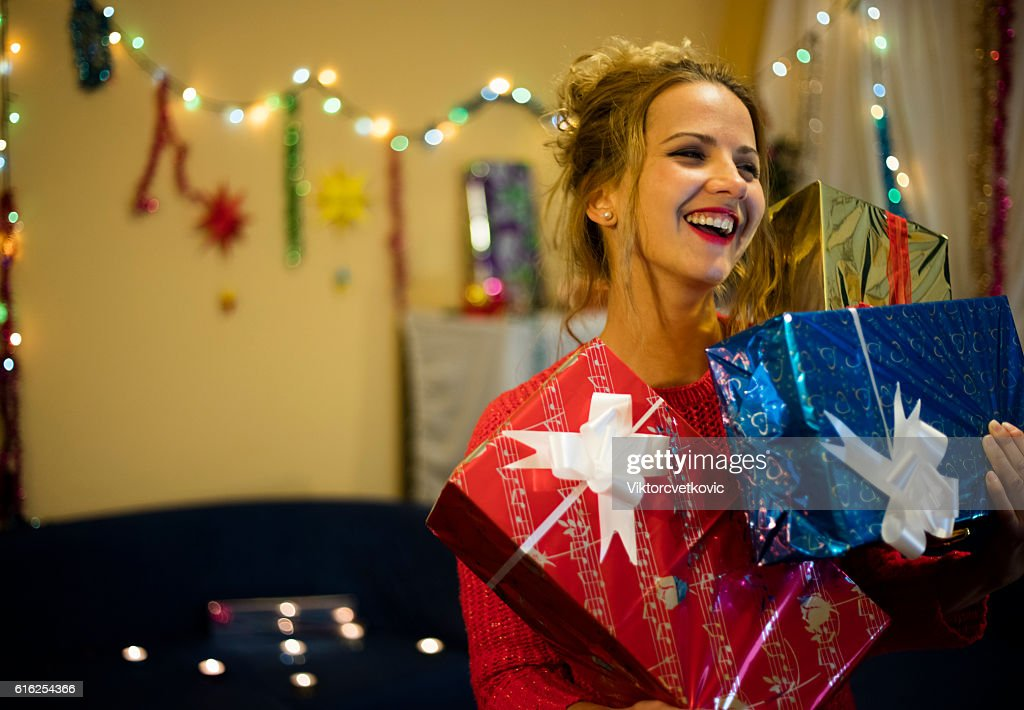 Smiling happy girl with Christmas presents. : Stock Photo