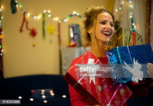 Smiling happy girl with Christmas presents. : Foto de stock