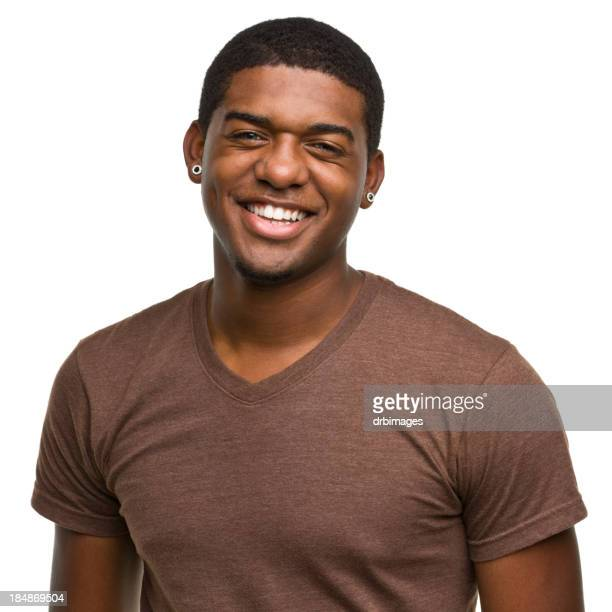 Smiling happy young male with earrings