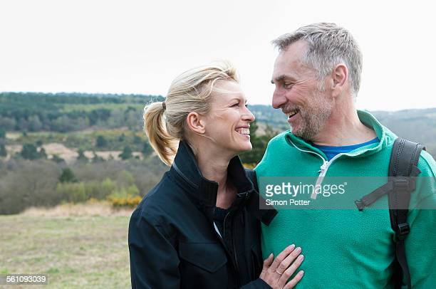 Smiling hiking couple in rural landscape
