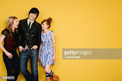 Smiling hipster friends engaged in conversation : Foto stock