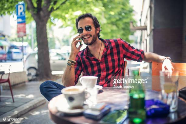 Smiling hipster talking on the phone