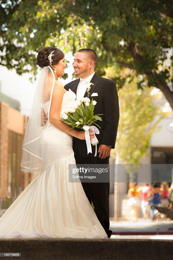 Smiling Hispanic bride and groom : Stock Photo