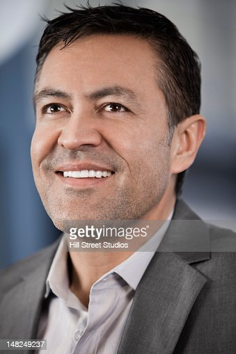 Smiling Hispanic businessman : Stock Photo