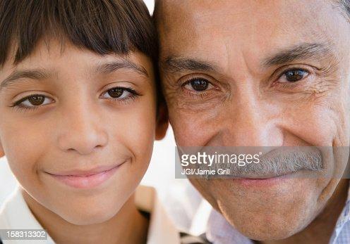 Smiling Hispanic grandfather and grandson
