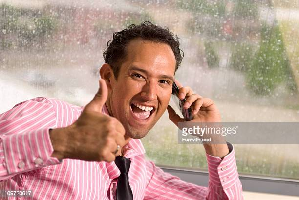 Smiling Hispanic Successful Businessman on Telephone: Salesman Giving Thumbs Upe