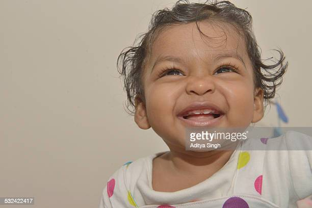 Smiling Indian baby girl