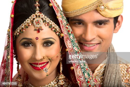 Smiling Indian Newlywed Couple In Traditional Wedding Dress Stock ...