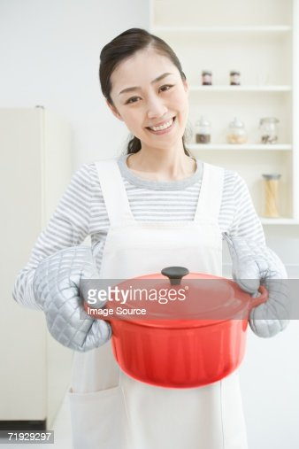 Smiling japanese housewife : Stock Photo
