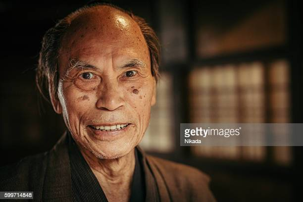 smiling Japanese senior in traditional clothes