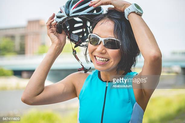 Smiling Japanese Woman Taking Off Helmet in Kyoto, Japan