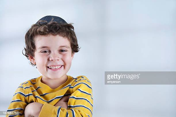 Smiling Jewish boy in striped yellow shirt