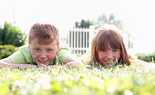 Group of two happy children on grass