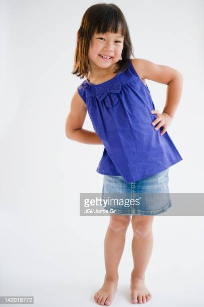Smiling Korean girl with hands on hips