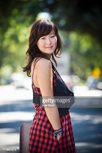 Smiling Korean woman standing outdoors