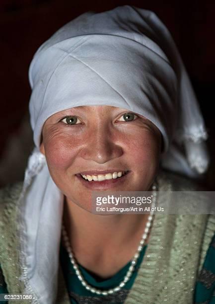 Smiling kyrgyz woman near Karakul lake Xinjiang Uyghur Autonomous Region China on September 21 2012 in Karakul Lake China