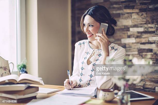Smiling latin woman working at home