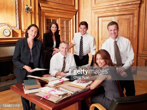 Smiling lawyers in office