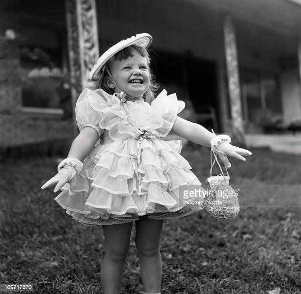 Smiling Little Girl in Fancy Ruffle Dress