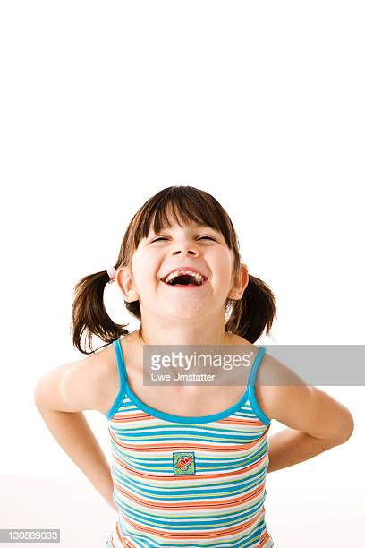 Smiling little girl with pigtails