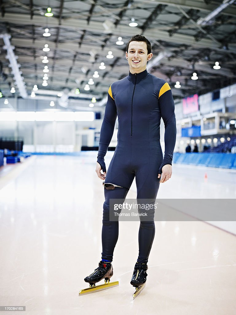 Smiling long track speed skater standing on track : Stock Photo