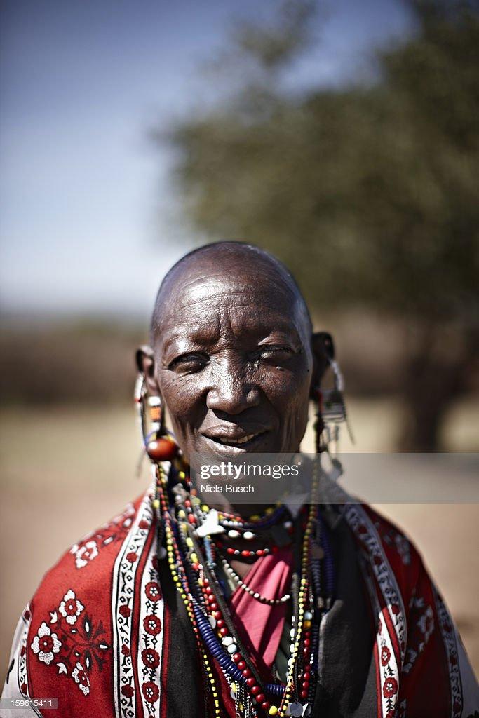 Smiling Maasai woman wearing jewelry