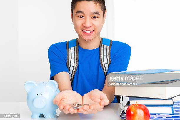 Smiling male student with coins in palm