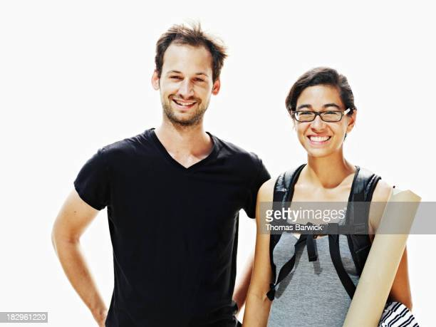 Smiling man and woman standing together