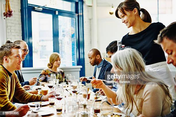 Smiling man dining with friends in restaurant