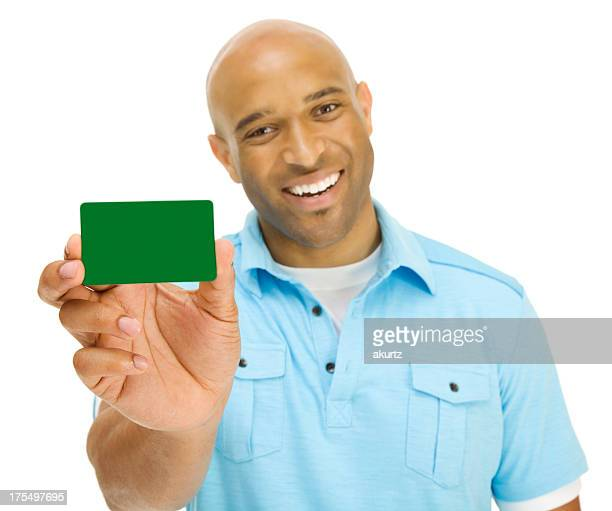 Smiling Man displaying blank green credit card