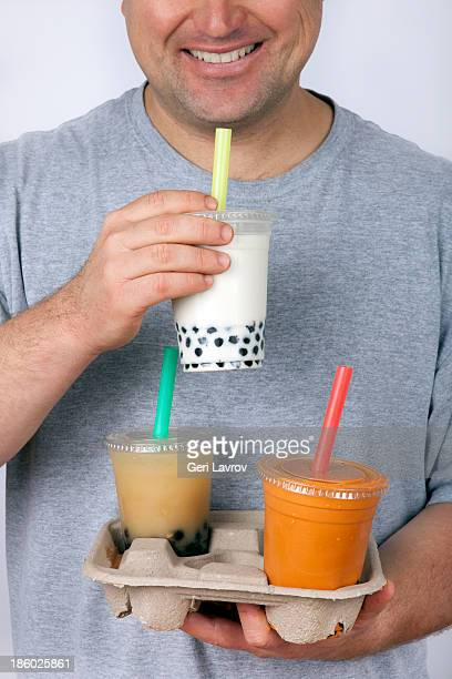 Smiling man drinking bubble tea