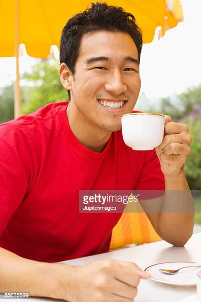 Smiling man drinking cup of tea