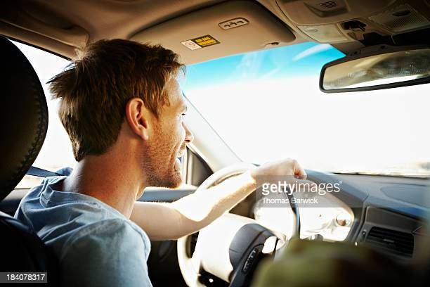 Smiling man driving car