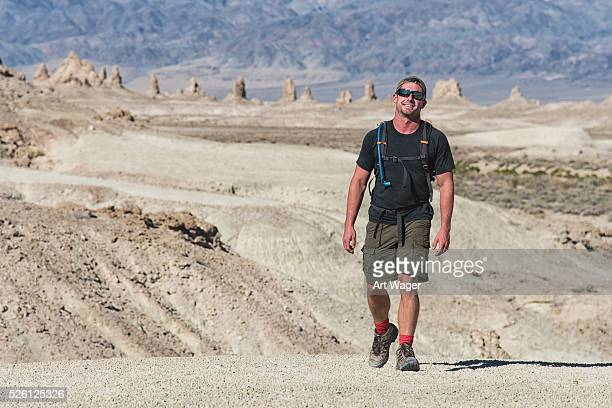 Smiling Man Hiking Across the Desert