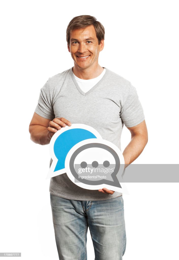 Smiling man holding chat sign isolated on white background. : Stock Photo