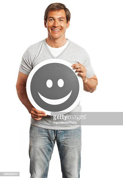 Smiling man holding happy smile sign isolated on white background.