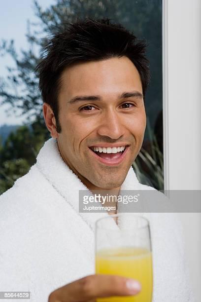 Smiling man holding mimosa