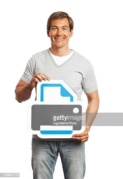 Smiling man holding printer sign isolated on white background.