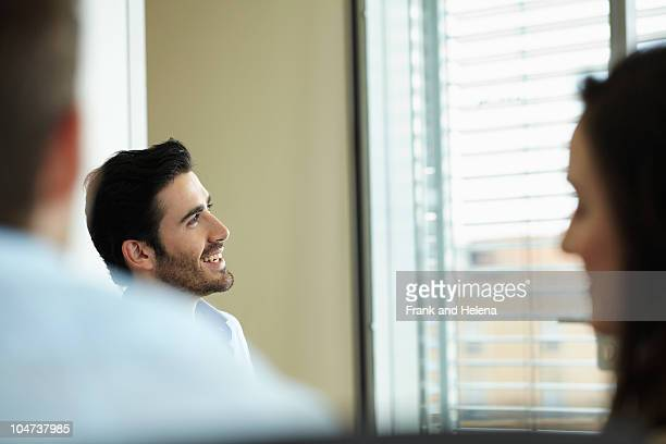 Smiling man in business meeting