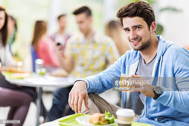 Smiling man in cafeteria.