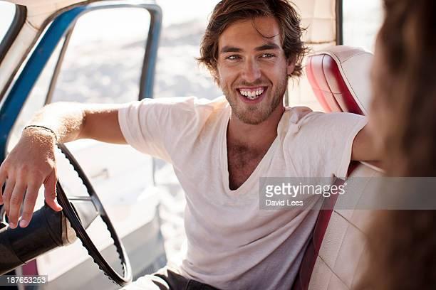 Smiling man in camper van